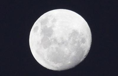 The moon. Milky white.