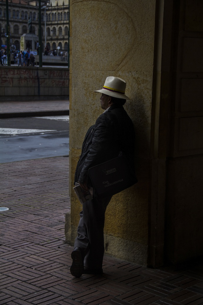 Local watches by in Bolivar Square, Bogota, Colombia