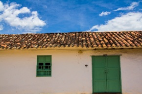 White house with green door and window, Barichara, Colombia