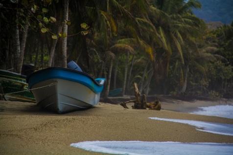 Blue boat in Playa Costeño, Colombia